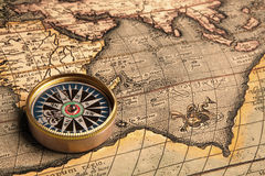 Vintage compass and old map Stock Photography