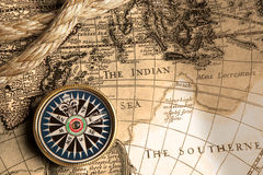 Vintage compass and old map Stock Images
