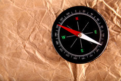 Vintage compass on old paper. The vintage compass on old paper Stock Photography