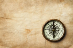 Vintage compass on old paper with copy space Royalty Free Stock Photos