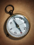 Vintage compass on old paper Royalty Free Stock Photo