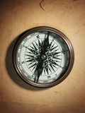 Vintage compass on old paper Stock Images