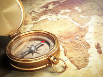 Vintage compass on the old world map. Travel concept. Vintage compass on the old world map with DOF effect. Travel concept. 3d Royalty Free Stock Photo