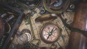 Vintage Compass On Old World Map royalty free stock images