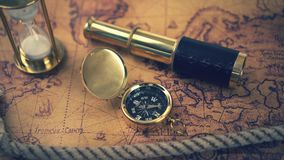 Vintage compass and other nautical equipment on ancient world map stock video