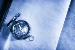 Vintage compass on paper Stock Photography
