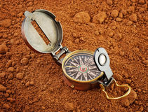 Vintage compass on red soil Stock Images