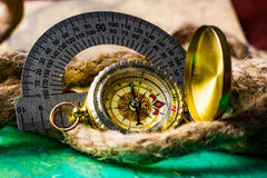 Vintage compass with rope Royalty Free Stock Photo