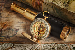 Vintage compass, telescope and map. Set of vintage instruments for navigation: compass, telescope and map stock photo
