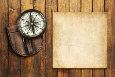 Vintage compass on the wooden background with the blank for your text Stock Photography