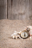Vintage compass with wooden fence and sandy background Stock Photography
