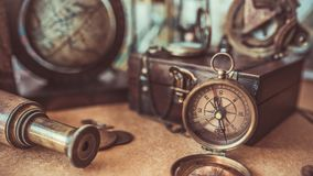Vintage Compass, Wooden Treasure Box, Telescope Old Collection Photos royalty free stock images