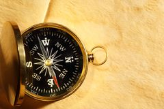 Vintage compass on yellowed paper. Vintage compass on blank yellowed paper Stock Photos