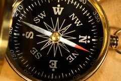 Vintage compass on yellowed paper Stock Image