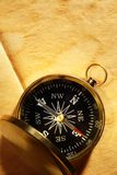 Vintage compass on yellowed paper Stock Images