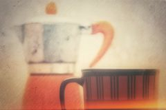 Coffee cup and kettle Stock Photography