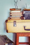 Vintage Composition with old books, suitcases and stool. Toning Stock Photography