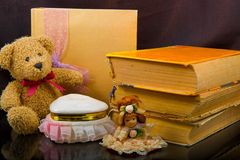 Vintage composition of old books, teddy bears, dolls Royalty Free Stock Images