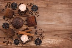 Vintage composition with rusty metal, candles and spices. On wooden background with copy space royalty free stock images