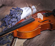 Vintage composition with violin and lavender Stock Photos