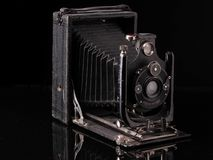 Vintage compur camera 1939 year release with reflection on black. Surface stock photos