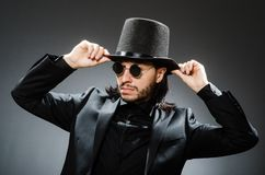 The vintage concept with man wearing black top hat. Vintage concept with man wearing black top hat stock photo