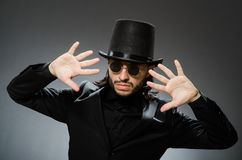 The vintage concept with man wearing black top hat. Vintage concept with man wearing black top hat stock image