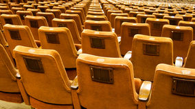Vintage concert hall seats. Concert hall with lots of seats and a imposing stage Royalty Free Stock Photography