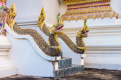 Vintage concrete guardian Thai Naga statues on temple stairway Stock Image