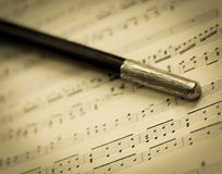 Vintage Conductor's Baton. A Vintage Antique  Ornate Conductor's Baton On Old Sheet Music Stock Photos