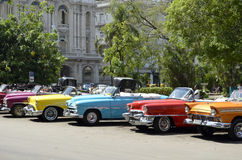 Vintage Convertible Cars of different colours in Havana (Cuba). Vintage Convertible Cars of different colours parked in a street of Havana (Cuba Royalty Free Stock Photography