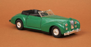 Vintage Convertible Coupe. Top down, Road Tough 8803, 1:32 scale diecast toy car (brown background Stock Images