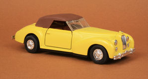 Vintage Convertible Coupe. Top up, Road Tough 8803, 1:32 scale diecast toy car (brown background Royalty Free Stock Image
