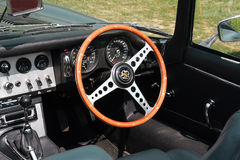 Vintage Convertible Sports Car Interior Closeup. Closeup of a vintage convertible sports car interior parked in a lawn area at daylight - E jaguar type Stock Photo