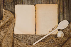 Vintage cookbook top view on old wooden food background Stock Photography