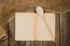 Vintage cookbook top view on old wooden food background Royalty Free Stock Images