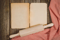 Vintage cookbook top view on old wooden food background Stock Photos