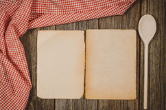 Vintage cookbook top view on old wooden food background Stock Images