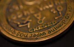 A copper coin on a black background royalty free stock photo