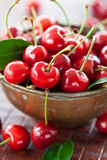 Vintage copper cup with fresh cherries Royalty Free Stock Photo