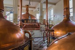 Vintage copper kettle - brewery in Belgium. Vintage copper kettle in brewery - Belgium Royalty Free Stock Photo