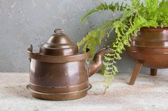 Vintage copper kettle on concrete background stock images