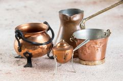 Vintage copper miniatures on concrete background. Copy space for text stock photo