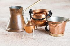Vintage copper miniatures on concrete background. Copy space for text royalty free stock image