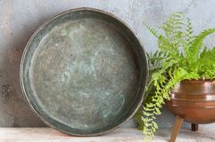 Vintage copper mold on a concrete background stock images