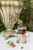Vintage copper samovar in a cup holder and a glass of hot tea cl Royalty Free Stock Photo