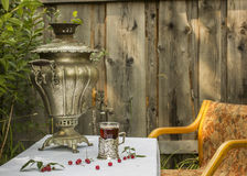 Vintage copper samovar in a cup holder and a glass of hot tea st Royalty Free Stock Photo