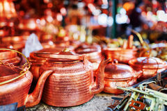 Vintage copper tea kettles at market in Lijiang, China. Vintage copper tea kettles at market in the Old Town of Lijiang, Yunnan province, China. Traditional stock photography