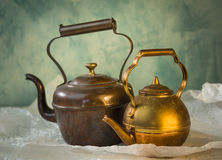 Vintage copper teapot. On the white wrinkled paper Royalty Free Stock Images
