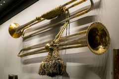 Vintage copper trumpets hang on wall close-up royalty free stock photos